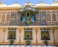 City Palace Udaipur interior artwork. View of City Palace complex in Udaipur, India. It`s nearly 400 years old built by Mewar dynasty royalty free stock image