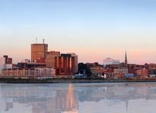 City panorama of Saint John, New Brunswick. City view of dowtown area of Saint John, New Brunswick, Canada with reflection in the evening at sunset royalty free stock photos