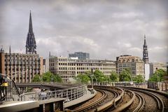 City panorama from subway. A view  on the city Hamburg from telpherage of subway in hafencity in retro style Royalty Free Stock Photo