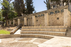 City park with ancient ruins Streets and houses in Jerusalem Stock Image