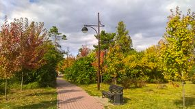 The city park in autumn colors stock image
