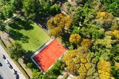 City park with basketball and soccer or football grounds at bright sunny day. Children playground in green recreation area. Aerial. Drone view outdoor sport stock photos