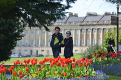 City Park. Bath, UK - May 3, 2016: People walk through Victoria Park below the landmark Royal Crescent. Bath is a UNESCO World Heritage city and a popular travel Royalty Free Stock Image