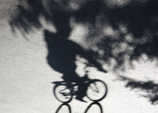 City park bicycle ride shadow royalty free stock photo