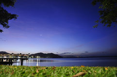 City park at dusk in Cairns, Australia. Looking out from the water front park in Cairns, Australia Royalty Free Stock Photos