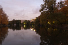 City park. In the fall quickly darkens and city park lamps are lit Stock Photo