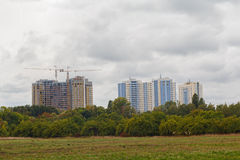 City park and high-rise buildings under construction Stock Photo