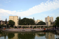City park with lake. A view across the lake at a city centre park in China Royalty Free Stock Photo