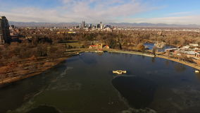 City Park Lake Denver Colorado Skyline Migrating Geese Birds Wildlife. High above Lake Ferril in Denver looking at some Geese who have stopped over for a rest stock video