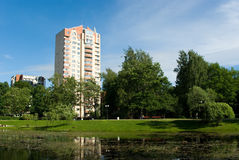 City park with modern apartment houses. City park with modern residential houses on background, Saint-Petersburg, Russia Royalty Free Stock Photos