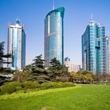 City park with modern building Royalty Free Stock Photo