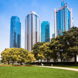 City park with modern building background in shanghai Stock Photos