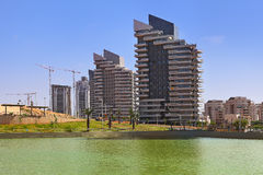 City park and modern building. Stock Photos