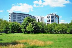City park with modern buildings background Royalty Free Stock Photo