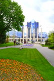 City park and modern glass building Royalty Free Stock Image