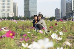 A young mother holds the boy happily in the city park Stock Photo
