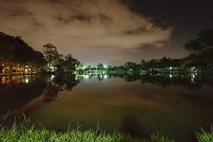 City park in the night with a resting place. The landscape of th. E city park in the winter stock photography
