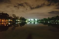City park in the night with a resting place. The landscape of th. E city park in the winter royalty free stock images