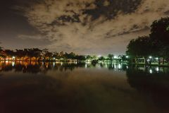 City park in the night with a resting place. The landscape of th. E city park in the winter stock photos