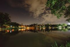 City park in the night with a resting place. The landscape of th. E city park in the winter stock images