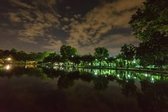City park in the night with a resting place. The landscape of th. E city park in the winter royalty free stock photos
