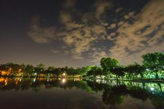 City park in the night with a resting place. The landscape of th. E city park in the winter royalty free stock image