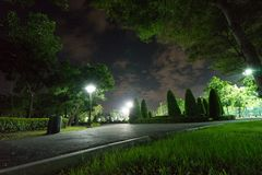 City park in the night with a resting place. The landscape of th. E city park in the winter stock photo