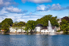 City park in Stavanger. Breiavatnet is the small lake with fountain situated in the centre of Stavanger, Norway Royalty Free Stock Photography