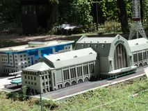 Layout of the station building at the exhibition of cues in miniature. City park summer open air layout of the station building at the exhibition of cues in royalty free stock photo