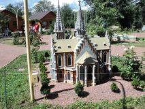 A model of the building of the church at the exhibition of cues in miniature. City park summer open air mock-up of the church building at the exhibition of cues stock images