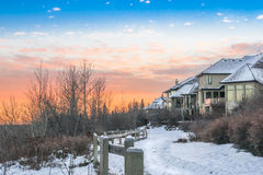City park trail in winter time. Along residential area and sunset back ground Royalty Free Stock Photos