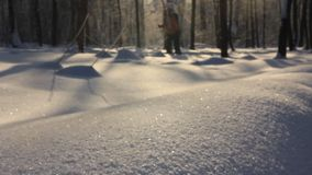 City park in the winter. Enjoy visiting skiers for a walk on a snowy piste stock footage