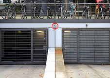 City parkinglot entrance with bicycles on top. Of doors Royalty Free Stock Images