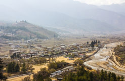 The city of Paro. A bird's eye view of the city of Paro, Bhutan. All houses are buildt in traditional bhutanese stile Royalty Free Stock Photography