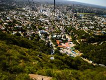 Beautiful high-rise view of a city from a chairlift Royalty Free Stock Photography