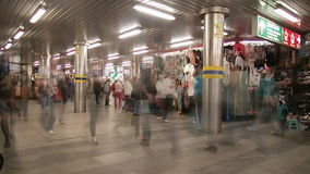 City passage with motion blur. City passage with peoples in motion blur stock footage