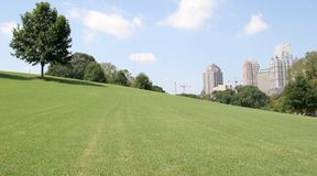 City Past Grassy Hill Royalty Free Stock Photos