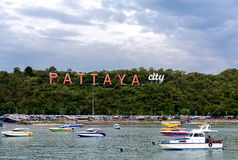 City of Pattaya sign with floating boat Royalty Free Stock Photos