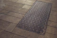 City pavement hatch Stock Images