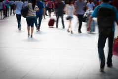 City people. Walking on piazza in motion blur Royalty Free Stock Images