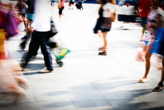 City people. Walking on piazza in motion blur Stock Photo