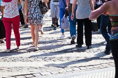 City people on the move. Crowds of shopping people are on the move in the pedestrian area Stock Image