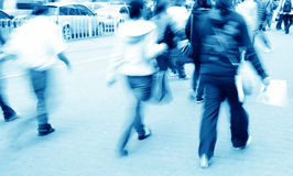 City people on street. Busy big city people walk on street at blur motion Stock Image