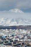 City Petropavlovsk-Kamchatsky and active Koryaksky Volcano Royalty Free Stock Photography