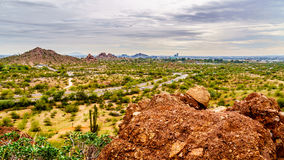 The city of Phoenix in the valley of the Sun seen from the Red Sandstone Buttes in Papago Park Royalty Free Stock Photography