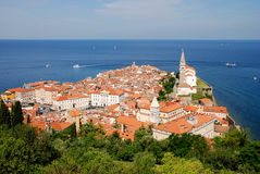 City Piran. View from above of Piran, coast city in Slovenia on sunny day with boats on the sea Stock Image