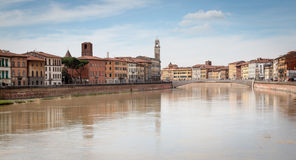 The city of Pisa along the Arno river. The river Arno splits the historic city in two parts. Allows for a beautiful stroll in a very historic setting Stock Photography