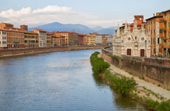 City of Pisa. Church, buildings at river Arno in the city of Pisa Stock Photos