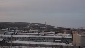 City plant in the winter. Industrial winter view at sunset with smoke stock footage