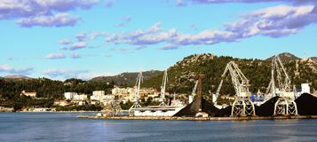 City of Ploce with cargo harbour distance view. Ploce,  Ploče near Dubrovnik. panoramic view of city and cargo harbour with cranes and oar Royalty Free Stock Photography